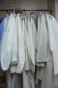 Doctor's Coats Hanging in Closet